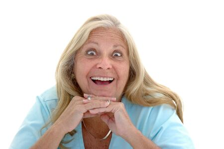 late fifties: Woman in her late fifties with a funny surprised expression photographed on a white background. Stock Photo