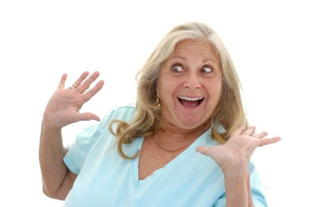Woman in her late fifties with a funny surprised expression photographed on a white background. photo