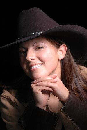 Moody Smiling Cowgirl portrait. photo