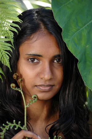shakti: Portrait of beautiful young woman from India in a tropical atmosphere.