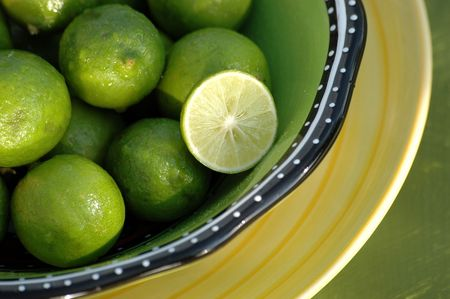 florida citrus: Key Limes in a bowl with one sliced. Stock Photo