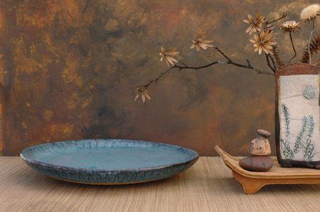 shiatsu: Zen spa still life with Raku vase, natural dried flowers, basin, and stones.