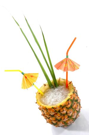daiquiri alcohol: High angle, Natural Pineapple hollowed out and filled with an icy drink and tropical umbrellas isolated on a white background.