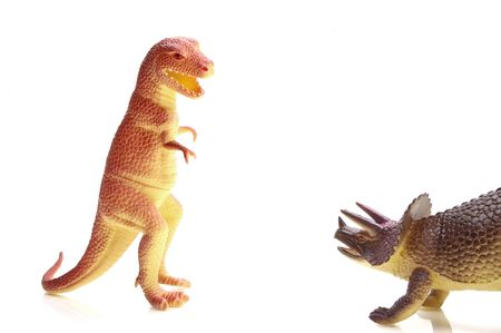 T-Rex and Triceritops meet up old enemies or friends...o see the entire sereis of dinosaur images keyword: dino1series Stock Photo - 327574