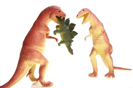 Two tyannosaurous rex dinosaurs and a meal. To see the entire series of dinosaur images keyword: dino1series photo