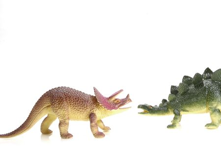 Two Different Dinosaurs Meet up. Isolated plastic toys. Stock Photo - 327569