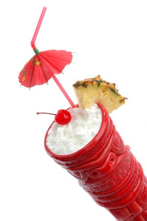 colada: Pina Colada, served in a red tiki mug photographed on white. A tropical drink made with coconut milk, pineapple juice and rum.