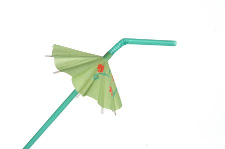 bendable: Green tropical drink umbrella isolated on a white background.