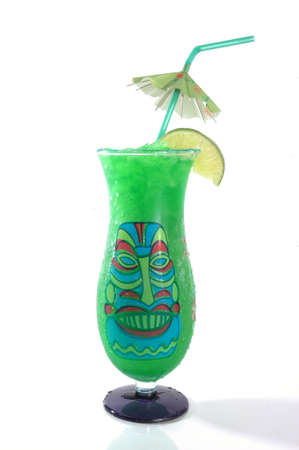 Lime tropical drink with Tiki face and umbrella isolated on a white background.
