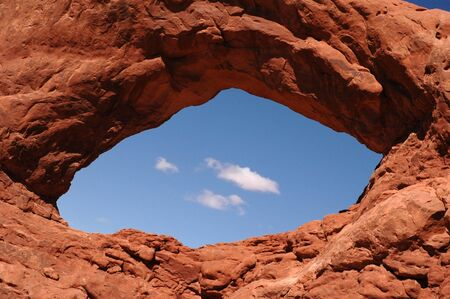 Natural stone Cosmic Eye arch with blue sky showing through.