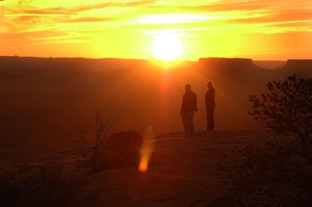 mesas: A senior couple experiencing the dramatic desert sunset over two mesas. Stock Photo