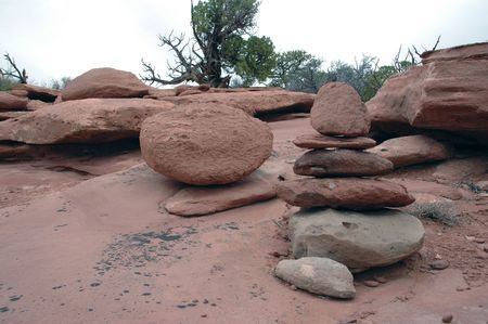 achievment: Shinto Sandstone. Stacked stones in a natural red sandstone environment. Stock Photo