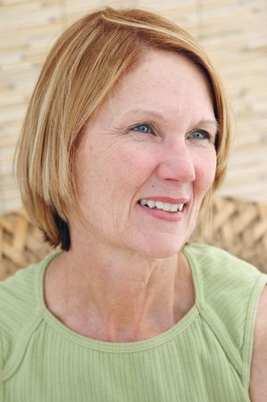 Natural senior woman smiling in a natural interior.