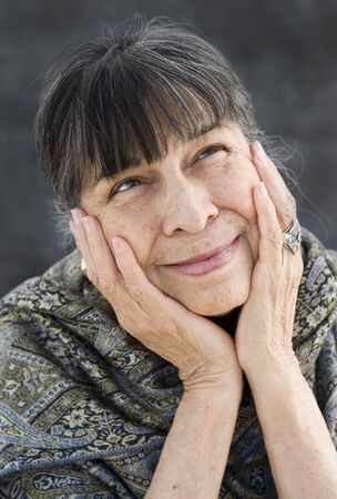 Portrait of a Hispanic Matriarch Daydreaming.