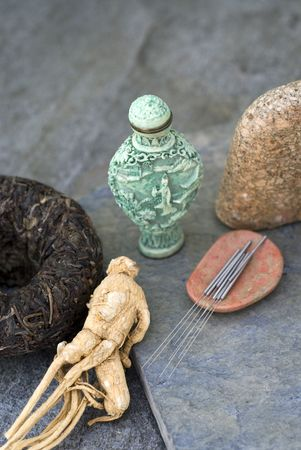 Traditional asian health items:black tea, ginseng, acupuncture needles, and medicine jar. Stock Photo - 659453