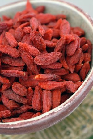 Tibetan Goji Berries noted for their high content of vitamins, polysaccharides, proteins, anti oxidants, and essential amino acids.  photo