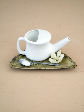 Ayurvedic sinus Neti Pot with salt.  Stock Photo