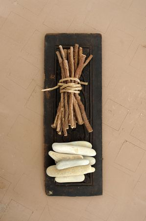 untruth: Still life photography of sticks and stones.  Stock Photo