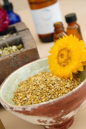 Whole Bee Pollen with other herbalists items.  Stock Photo