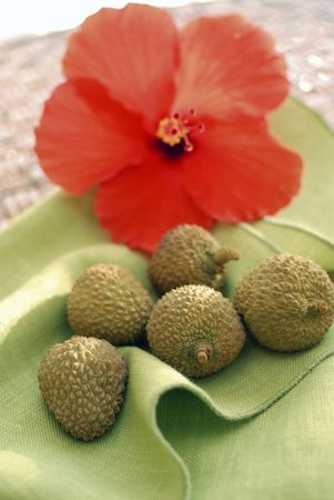lychees: Chinese fruit often grown in Hawaii. lychees and hibiscus.