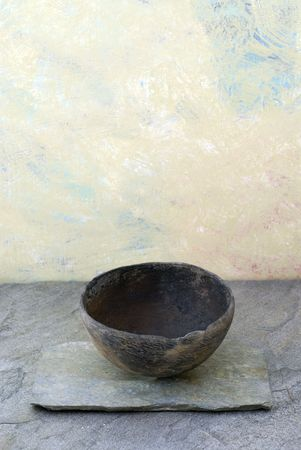 Empty ancient bowl in a still life setting.  Stock Photo
