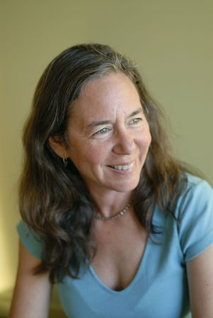 Soft natural portrait of a smiling middle aged woman.  photo