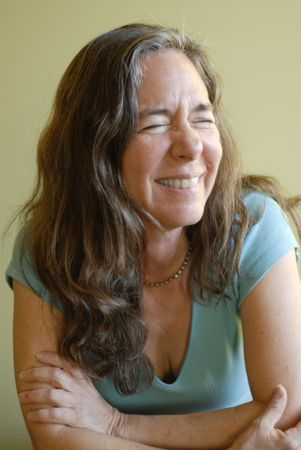 Soft natural portrait of a laughing middle aged woman.  photo