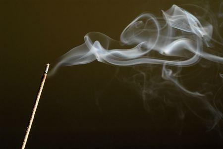 Burrning incense stick with smoke.