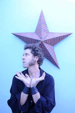 egoist: Portrait of a man with a star background.