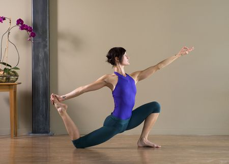 mudra: Dancer in yoga lunge with mudra.  Stock Photo