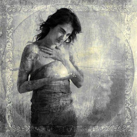 Woman holding light energy. Photo based illustration.