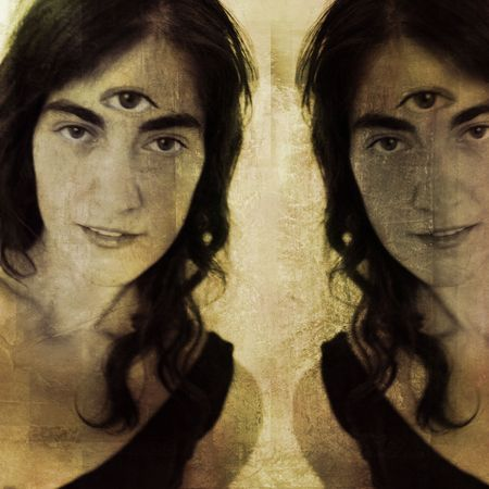 Woman with third eye and her reflection (or double). Photo based illustration.  illustration