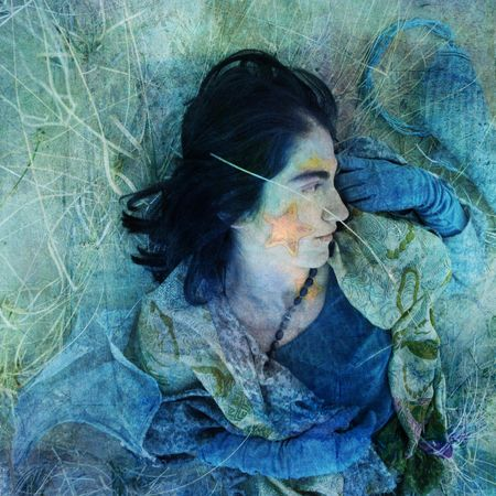 Reclining silk clad woman with star on her face. Photo based illustration.   Stok Fotoğraf