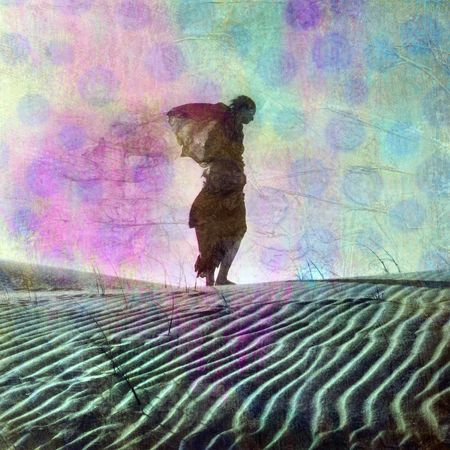 sadness: Abstract female figure in desert dune. Photo based illustration.