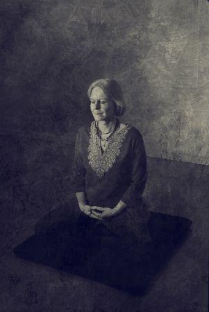 Woman in meditation pose indoors.  Foto de archivo