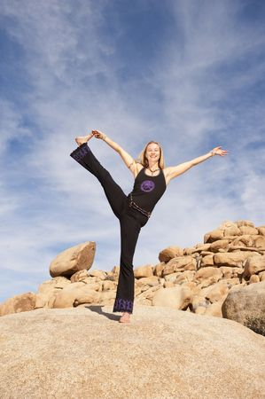 Woman in powerful joyful yoga pose outdoors. Stock Photo - 6862838