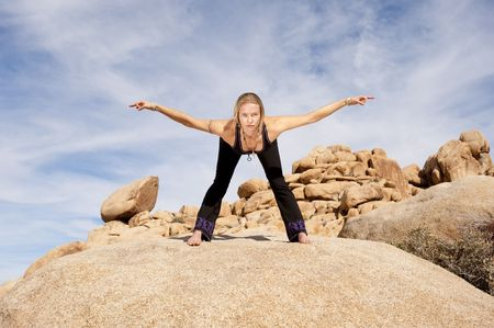 Woman in yoga pose bowing with hands in meditation mudra outdoors. Elise Kost jewelry. Stock Photo - 6862831