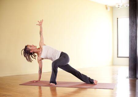Unique woman in yoga pose indoors.