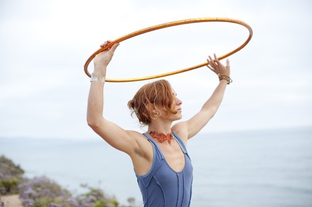 Woman with hoop and the sea and the sky.