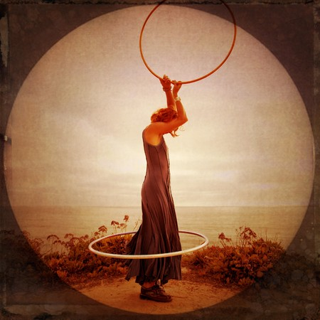 enso: Anonymous woman by the sea with hoops. Photo illustration.
