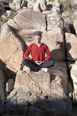 Man in yoga pose outdoors.