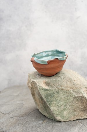 A beautifully imperfect ceramic bowl. Stock Photo