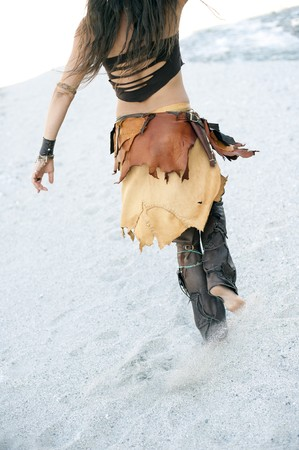 Modern Tribal wear.  Handmade leather skirt and pants by WolfWears.  photo