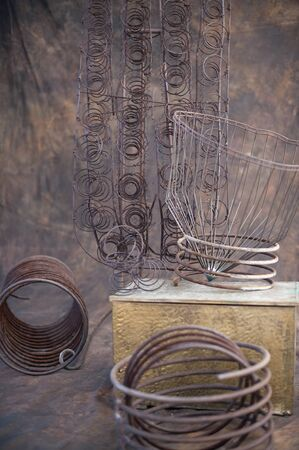 chaos theory: Rustic spiral scrap metal shapes in a still life setting.