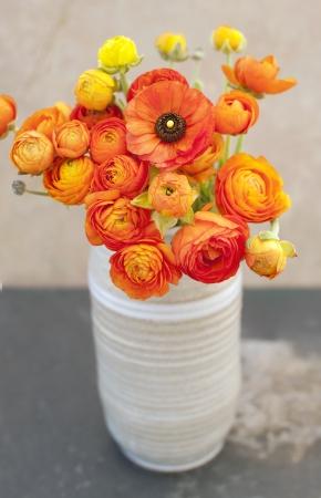 vase: Ranunculus flowers in a vase