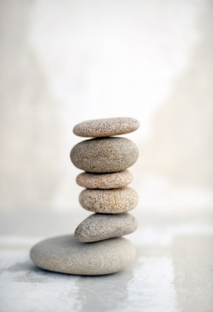 earth tone: Abstract painting and stones stacked in simple balance