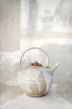 Ceramic teapot in a matching environment   photo