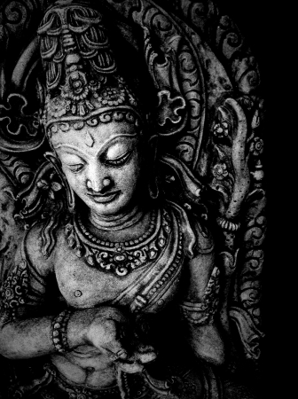 Wood statue of an Indian god photographed in black and white