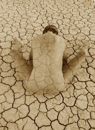 Abstract female figure be-coming from cracked clay.  Stock Photo - 15512665