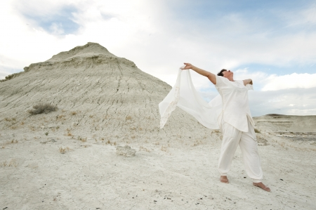 body heart: Mature woman in open hearted pose outdoors in a pristine desert location   Stock Photo